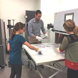 Girl making a brace with orthotists at National Scoliosis Center